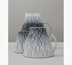 Nicola Tassie, Set of Three Porcelain with Black Iron Inlay Jugs, 2013