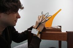Playing the FingerSynth instrument on different resonant objects