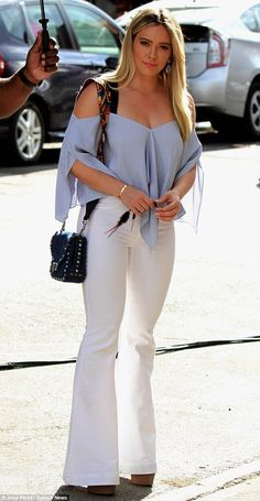 Hilary Duff struts her stuff in body-hugging bell bottoms | Daily Mail Online