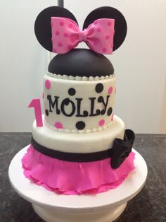 - Minnie Mouse First Birthday.  Love the little skirt on this cake.