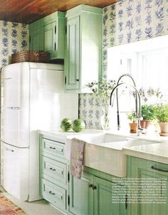 Elmira retro refrigerator. Delft blue tiles from Country Floors. Pine cabinets stained with Benjamin Moore's Everglades. Missouri lake house built in the 1940s. Photography by James Merrell.  Interior design by Rhoda Burley Payne. House Beautiful (September 2011).