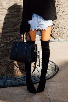 thigh-high boots with shredded denim shorts