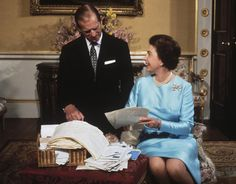 express: Queen Elizabeth II and Prince Philip sort through a basket of mail on the occasion of their 25th wedding anniversary in 1972