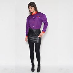 He encontrado este interesante anuncio de Etsy en https://www.etsy.com/es/listing/265418603/vintage-anos-80-purpura-camisa-boton