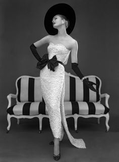 Model in John Cavanagh's strapless evening gown, photo John French. Black and white photography. London, UK, Spring 1957.