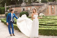 hola - Vue Photography Bride and Groom walking through the Vizcaya Museum and Gardens dress by: Mira Zwillinger Grooms suit: Michael Andrews Bespoke Shoes: Jimmy Choo