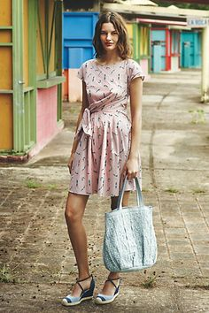 I'm not sure about the color of this dress, but the style with the side tie waist looks interesting!  Bathing Beauty Dress #anthropologie