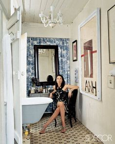 The eclectic master bath in artist Anh Duong's New York City apartment/studio features a graphic floral mosaic-tile floor and a Murano-glass chandelier; the works of art include Julian Schnabel's painting Anh and Duong's The Man with the Tiara. - ELLEDecor.com