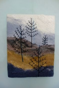 Felted picture ,felted landscape with winter trees in the mist, after felting the background I embroidered the stylised trees making a lovely felt picture or fibre art painting. The white sky has silk fibres felted in which give a lovely sheen,it is then stretched around a canvas and is