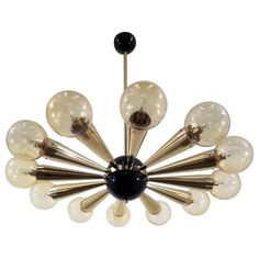 For Sale on - Italian chandelier with amber Murano glass globes with carefully blown bubbles within the glass using Bollicine technique, mounted on polished brass frame Murano Chandelier, Italian Chandelier, Italian Lighting, Chandelier Pendant Lights, Modern Chandelier, Ceiling Canopy, Ceiling Lights, Canopy Design, Mid Century Modern Furniture