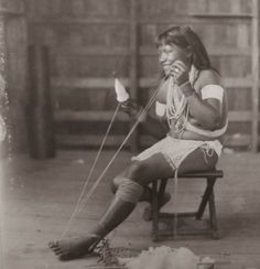 Wai-Wai woman spinning cotton; 1925. Guyana. (photo R.H. Carr family album)
