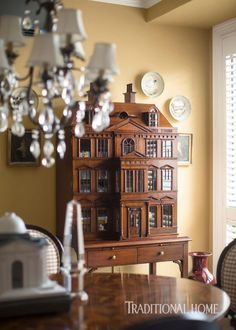 This reproduction Georgian piece is a family heirloom that now stows some of the homeowner's many books. - Photo: John Bessler / Design: Tim Gunn