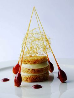 Gingerbread, white chocolate cream decorated with caramel spears and raspberry puree
