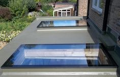 These contemporary skylights add plenty of natural light to this flat roof extension. Contemporary Skylights, Contemporary Front Doors, Bungalow Extensions, House Extensions, Flat Roof Skylights, Roof Extension, Extension Ideas, Kitchen Extension Flat Roof, Extension Google