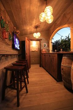 Complete with a hidden bar of pirate booty, this party bar shed is perfect. Between the reclaimed wood and whiskey barrels, this backyard man cave would be right at home on the high seas. Backyard Shed Man Cave, Man Cave Shed, Man Shed, Backyard House, Backyard Gazebo, Man Cave Home Bar, Wedding Backyard, Pool House Shed, He Shed She Shed