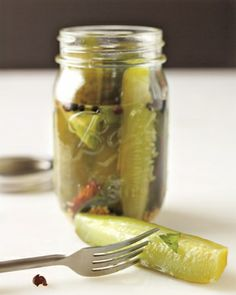 Canned Sour Pickles and Pickling Spice -Cucumbers brined in vinegar solution and shot through with pepper and spice make spirited -- and addictive -- snacks. Sour Pickles, Pickles Recipe, Butter Pickles, Canning Pickles, Great Recipes, Favorite Recipes, Recipe Ideas, Recipe Tips, Veggie Recipes