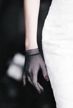 a fishnet glove with red manicure and white dress... how lovely