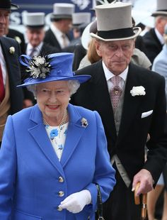 Queen Elizabeth II at the start of the Diamond Jubilee Celebrations at the Epsom Derby 2012 wearing her grandmother's brooch and pearl earrings