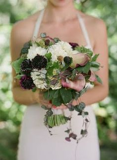 White dahlia, burgundy buttons, blackberries, calla lilies and ivy