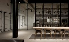 This raw, essential space was designed by Pitsou Kedem Architects for the new showroom of the German kitchen company bulthaup in Tel Aviv, Israel. Retail Interior, Cafe Interior, Interior Design, Shop Interiors, Office Interiors, House Doctor, Commercial Design, Commercial Interiors, Bulthaup Kitchen