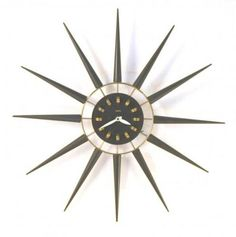 Snider black Spanish-style starburst wall clock (electric, early 1960s)