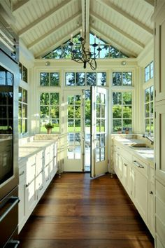 Love the idea of putting the kitchen in the conservatory! Though could be creepy at night when you're staring into black darkness - high murderer potential