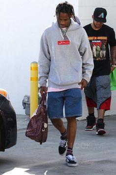 Travis Scott wearing  Vans Old Skool Suede Sneaker, Supreme Arabic Hoodie