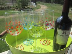 DIY Hand Painted Wine Glasses (Dollar Store)  Arcrylic paint, place in cool oven, heat to 350 for 30 mins.