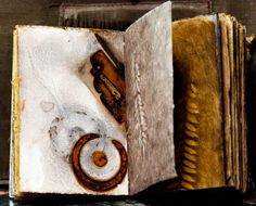 Leslie Marsh of Snips and Snails and Puppy Dog Tails - artists book  As Luck would Have It / The pages were rusted and dyed