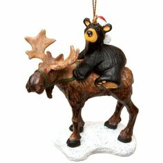 Bearfoots Bear in santa hat is holding the reigns on a large moose and going for a ride! Cord hanger H. From Big Sky Carvers. Christmas Tree Ornaments, Christmas Decorations, Holiday Decor, Christmas Ideas, Christmas Time, Moose Lodge, Christmas Animals, Big Sky, Black Bear