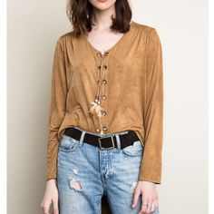 """Sea Fever"" Faux Suede Lace Up Top Long sleeve faux suede lace up top. Feel like a boho rock star in this beautiful top! Available in camel and rust. This listing is for the CAMEL (first three photos). Brand new. 100% polyester. NO TRADES DON'T ASK. Bare Anthology Tops Blouses"