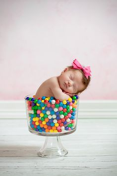 It is hard to look at this and not smile.  Not sure if I think the oversized bow is more funny than the stickiness of gumballs on a sweaty baby, but either way, it's funny.