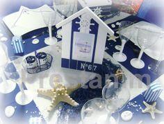 Une idée déco centre de table avec une cabine plage  bleu blanc