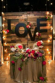 Wedding reception backdrop - A sweetheart table one could only dream about! Nicole Ha Design styled our Reclaimed Barn Wood Walls, Love monogram letters, and market lights Napa Valley Linens sequin tablecloth adds the perfect am Wedding Reception Table Decorations, Party Decoration, Wedding Table, Rustic Wedding, Our Wedding, Bridal Table, Pallet Wedding, Wedding Ideas, Wedding Vintage