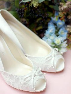 Lace Ivory Wedding Shoes Comfort Fit Satin Heel 2 1/4 Embellished with lace *Custom embellishing available in drop down box *Scattered Swarovski crystals *Scattered pearls *Swarovski crystal heel *Swarovski crystal heel seam SIZING & WHITE SHOE SERVICE Although we feel the shoes fit