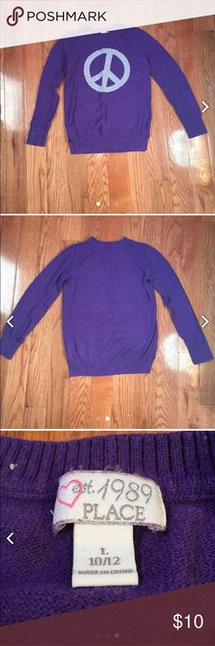 A purple sweater This purple sweater has a gray peace sign on it. Size 10/12. From Children's Place. Great for winter! COMES WITH FREE GIFT!❤️ Children's Place Shirts & Tops Tees - Long Sleeve