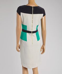 Polished in a structured, figure-flattering fit, this cap-sleeve dress is embellished with color block panels. Lightweight, stretchy fabric construction keeps you feeling comfortable, and a zipper closure simplifies wear.