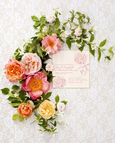 beautiful shot with flowers and invitations!