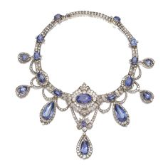 FROM THE COLLECTION OF A ROMAN PRINCELY FAMILY - Sapphire and diamond necklace, circa 1880 - Set with cushion-, oval and pear-shaped sapphires highlighted with cushion-shaped, circular-, single-cut and rose diamonds, inner circumference 310mm, with additional later added link length approximately 363mm.