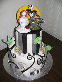 Nightmare Before Christmas Wedding Cake - A comination of designs (cake inspired by Pink Cake Box and topper inspired by Hildoom on Etsy)  The topper I sculpted out of sculpey and the moths are edible rice paper.
