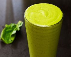 Spinach Green Smoothie with Yogurt  1/2 bunch spinach  1 cup yogurt  1 red delicious apple, chopped  1 cup frozen mango chunks, or fresh  1 tablespoon honey or agave syrup  1 cup water or ice