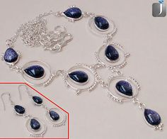 Graceful set of sterling silver necklace and earrings with precious Blue Goldstone carved delightfully...