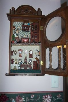 """~ Julie Craig ~ I bought this old clock case from an op shop for 5 dollars!!! I ripped out the non-working parts and made a clock shop and the clock maker lives upstairs. His name is Mr Tock and his little doggie is named """"Tick""""!"""