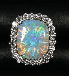 Beautiful Jewelry Magnificent Australian Opal, Cushion Cabochon with a Large Diamond Halo, White… Opal Jewelry, I Love Jewelry, Jewelry Box, Jewelry Rings, Jewelery, Jewelry Accessories, Fine Jewelry, Jewelry Design, Silver Jewellery