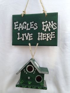 The bird house fan signs are made for the sport lovers. The pictures show an example of what Philadelphia Eagles Fan House would look like.There is the option of a big or smaller fan house. Philadelphia Eagles Fans, Fly Eagles Fly, Christmas Ornaments, Holiday Decor, Front Porch, Unique Jewelry, Handmade Gifts, Fence, Etsy