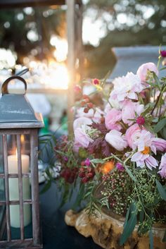A few subtle enhancements, including hurricane lanterns and natural arrangements done by Singletary's Flowers, a local florist, highlighted the already idyllic outdoor setting.  (Photo Credit: Shawn Connell/Christian Oth Studio)