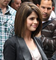 Cute bob haircut. I'm trying to stay away from this clean-cut, girl next door look though.
