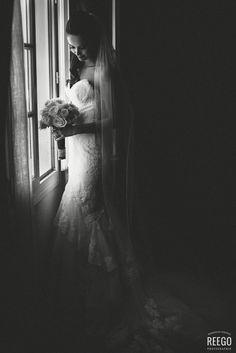 Bride in shadows #bride #shadows #bw #light #window #bouquet #blackandwhite