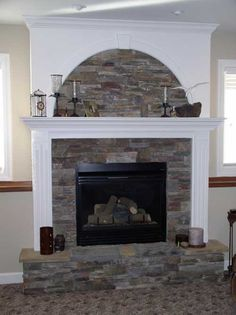 stone fireplaces with white wood surround | White wood and stone ...