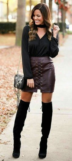Sexy burgundy front laced leather skirt with black OTK boots #highheelbootsskirt #blackhighheelsstockings